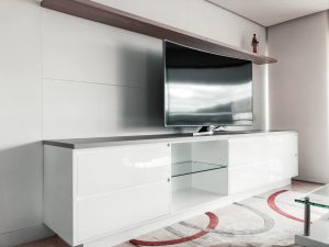 black-flat-screen-tv-on-white-wooden-tv-rack-3637737